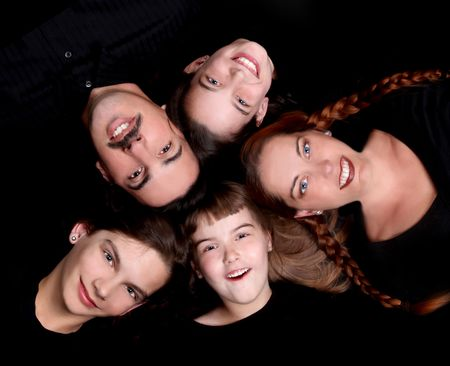 Family of 5 Portrait Lying Down in a Circle on Black Stock Photo - 4084926