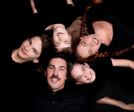 Family of 5 Portrait Lying Down in a Circle on Black Stock Photo - 4084925