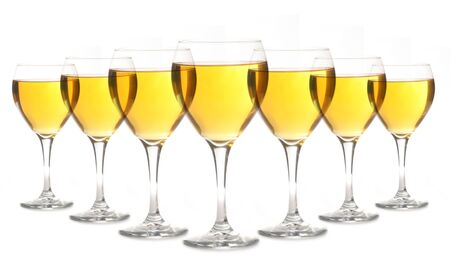 lined up: Glasses of Golden Alcohol Lined up on White Background
