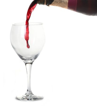 Red Merlot Wine Pouring into a Chilled Glass on White Background With Copy Space Stock Photo - 4090460