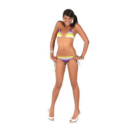 Smiling Pretty African American Woman Wearing a Bikini on White Background photo