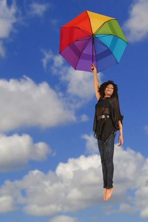 Happy Woman Falling From the Sky Holding Colorful Umbrella photo