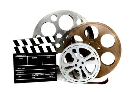 canister: Film Canisters With Directors Clapboard on White Background