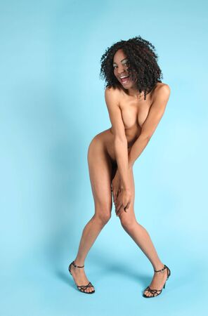 naked african: Nude African American Woman on Blue Background Smiling