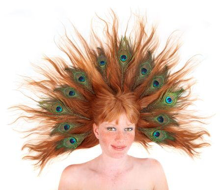Redhead With Peacock Feathers in Her Hair on White Background photo