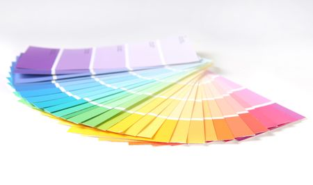Bright Colorful Paint Swatch Samples for Remodeling a Home or Office on White Background. Shallow Depth of Field. photo