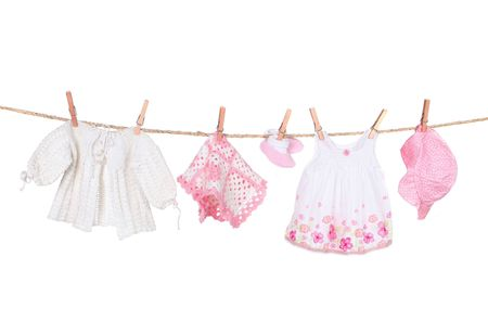 crochet: Baby Girl Clothing Hanging on a Clothesline Isolated on White Background