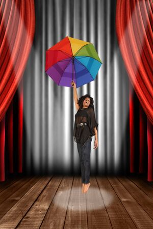 archiitecture: Black Woman on Theater Stage With Umbrella Singing