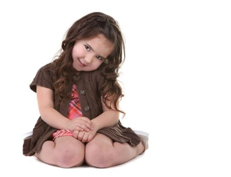 tilting: Cute Brown Haired Young Girl Tilting Her Head Sideways Stock Photo