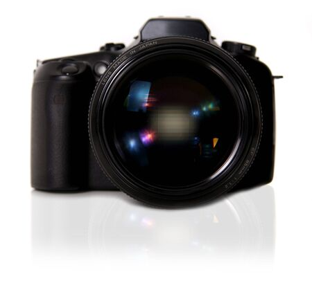 DSLR Camera on White Background With Mirror Shadow Stock Photo