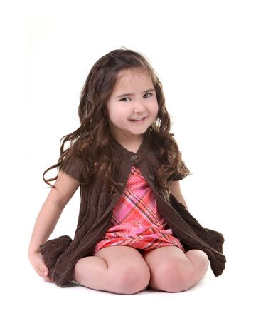 Adorable Young Child Smiling and Sitting on Her Knees With White Background Stock Photo - 4595944