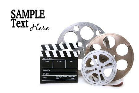 clapboard: Movie Production Film Canisters With Directors Clapboard on White Background and Copy Space
