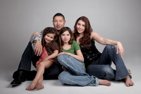 blended: Beautiful Loving Family of 4 on Grey Background