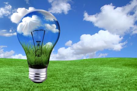Global Concept of Green Energy Solutions With Light bulb and Planet on Bright Landscape Stock Photo - 4601992