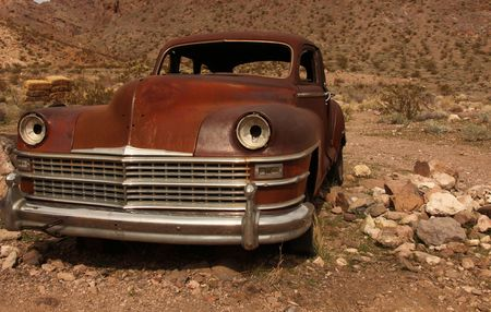 Horizontal Image of a Rusted Out Old Amercian Classic Vehicle photo