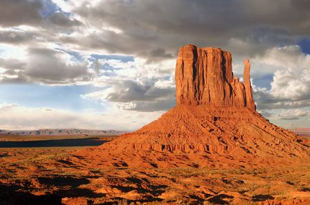 gigantic: Monument Valley Buttes With Clouds at Sundown Stock Photo