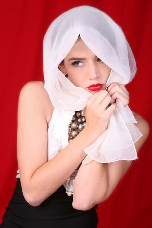Beautiful Woman With White Scarf Wrapped Around Her Head photo