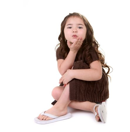 Beautiful Young Child Blowing a Kiss on White Background