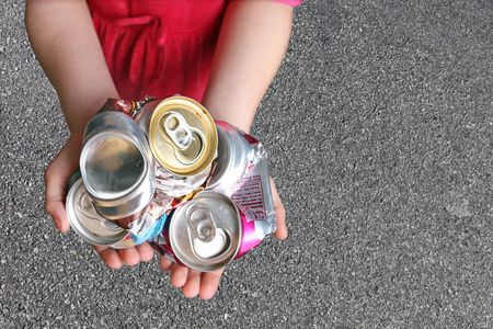 Recycling Aluminum Cans in a Childs Hands photo