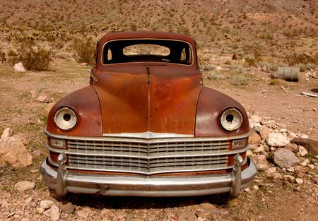 Sad Rusted Out Used Up Vintage Vehicle Left in the Desert to Rot photo