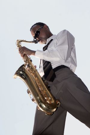 african sax: African American Jazz Music Player Outside Stock Photo