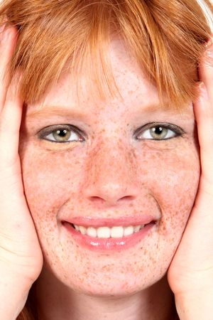 Beautiful Freckled Model Closeup With Hands Framing Her Face photo