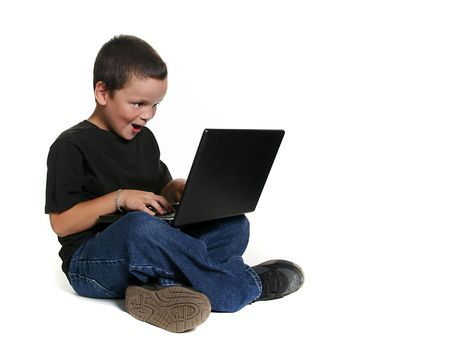 Excited Young Child Working on Computer photo