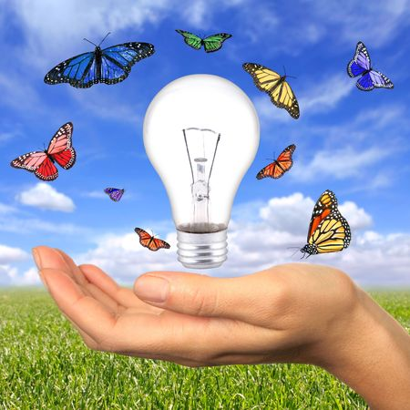 bright idea: Woman Holding Lighbulb Concept of Clean Renewable Energy of the Future Stock Photo