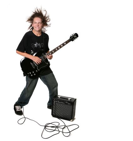 Electric Guitar Playing Teenage Kid With Eyes Closed on White Background photo