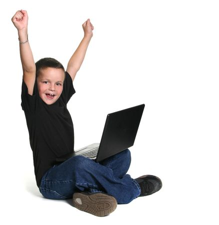 Excited Young Child Working on Computer With Arms Up in Excitement photo