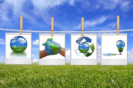 フィルムの空白内ロープにぶら下がってグリーン エネルギー ソリューションのグローバル ・ コンセプト 写真素材