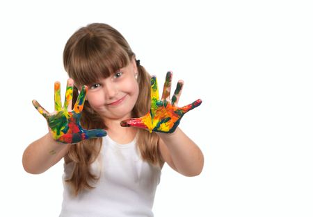Smiling Day Care Preschool Child Painting With Her Hands. Only Hands Are in Focus. Imagens