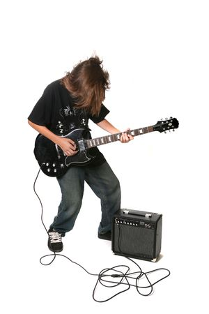Teenager Playing Electric Guitar With Amplifier on White Background photo