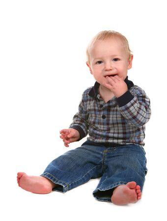 Happy Boy Toddler With Hand in His Mouth on WHite Background Stock Photo - 5128105
