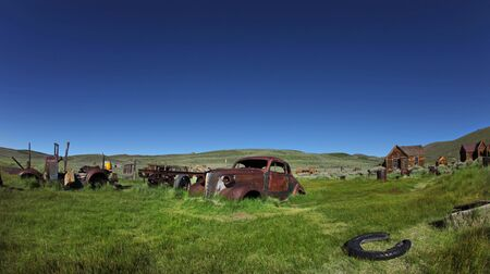 bodie: Field of Vintage Vehicles in Historical Bodie California Stock Photo