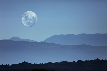 Beautiful Ghostly Mountain Silhouettes and Moon Moonscape