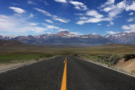 sierra nevada mountains: Wide Open Rural Road in the Eastern Sierras Stock Photo