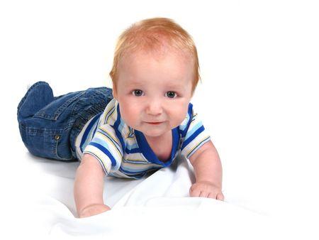 lying on his tummy: Infant Baby Boy Lying on His Tummy on White Background Stock Photo