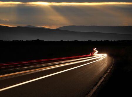 lifelike: Night Time Car Light Trails in the Mountains Stock Photo