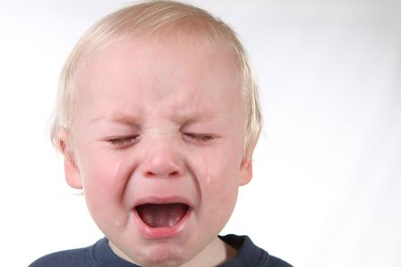 whine: Mad Screaming Little Boy With Tears Streaming Down His Face Stock Photo