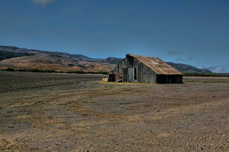 Rickety Old Abandoned Farm Barn in the Hills of Hollister California photo