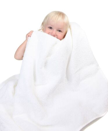 Cute Baby Boy Holding Towel to His Face Smiling Stock Photo - 5404193