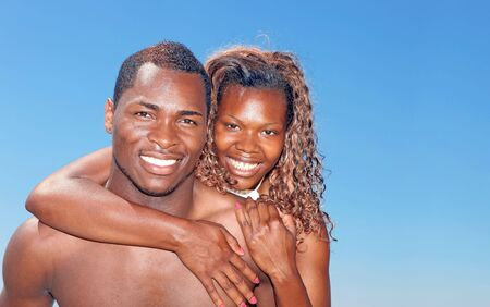 Happy Image of an African Amercian Couple Smiling Outdoors photo
