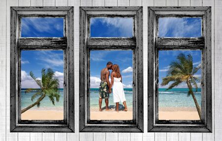 African Amercian Couple on the Beach Through a Cottage Home Window photo