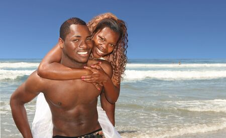 Happy African American Couple Smiling on the Beach Outdoors photo