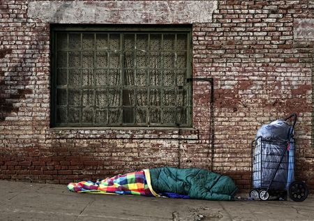 sleeping bag: Homeless Soul Sleeping on the Streets in a Sleeping Bag Outdoors