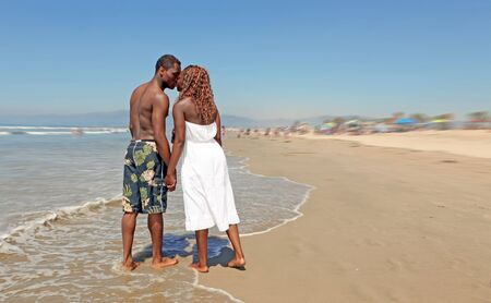 Loving African American Couple Kissing on the Beach photo