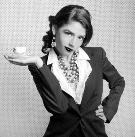 Sexy Woman Dressed in Retro Vintage Style Holding a Teacup in Black and White photo