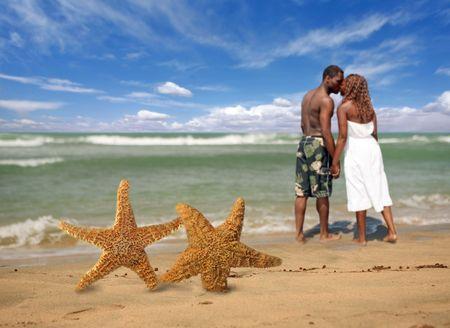Couple Kissing Along a Tropical Beach Setting photo