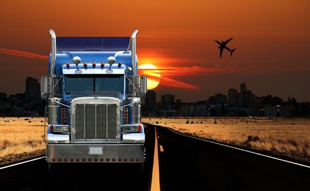 truck: Semi Truck Traveling Through a City at Sunrise